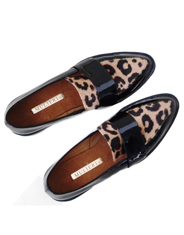 black loafers and animal print mulieri